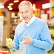 Man in a supermarket — Stock Photo