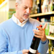 Man in a supermarket — Stock Photo #23284234