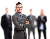 Businessman in front of his team — Stock Photo