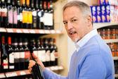 Man choosing wine — Stock Photo