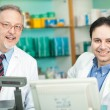 Stock Photo: Pharmacists at work