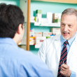 Stock Photo: Pharmacist at work