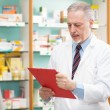 Stock Photo: Pharmacist reading prescription