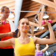 Woman working out in a fitness club — Stock Photo