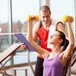 Woman working out in a fitness club — Stock Photo #23609965