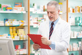 Pharmacist reading a prescription — Stock Photo
