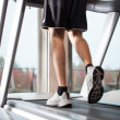 Man running on a treadmill - Stock Photo