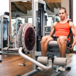 Man working out in a gym - Foto Stock