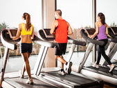 Running on treadmills — Stockfoto