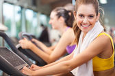Woman training in a fitness club — Stock Photo