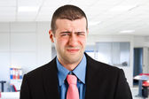 Suffering businessman — Stock Photo