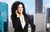 Attractive businesswoman talking on the phone — Stock Photo