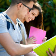 Portrait of two students talking in a park — Stock Photo