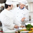 Professional chefs at work — Stock Photo #27202539