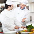 Stock Photo: Professional chefs at work