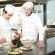 Professional chefs at work — Stock Photo #27202791