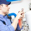 Hot-water heater service — Stock Photo #27203743