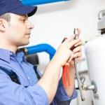 Hot-water heater service — Stock Photo