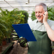 Gardener talking on the phone — Stock Photo