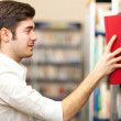 Student taking a book — Stock Photo