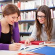 Students at work in a library — Stock Photo #27205291