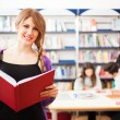 Students in a library — Stock Photo #27205477
