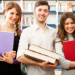 Students in a library — Stock Photo #27205567