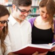 Students in a library — Stock Photo #27205611