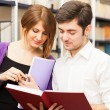 Friends reading a book — Stock Photo