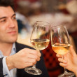 Stock Photo: Couple toasting wineglasses