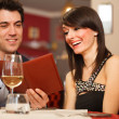 Stock Photo: Couple reading menu