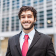 Stock Photo: Young smiling business man