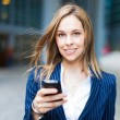 Woman using a cell phone — Stock Photo #27209211