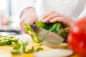 Chef at work in his kitchen — Stockfoto