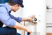 Hot-water heater service — Stockfoto