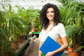 Worker examining plants — Stock Photo