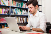 Student using a laptop — Stock Photo