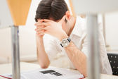 Stressed student reading a book — Stock Photo