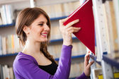Woman taking a book — Stockfoto