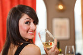 Girl drinking wine in a restaurant — Stok fotoğraf