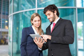 Business using a tablet — Stock Photo