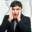 Astonished businessman — Stock Photo