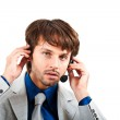 Young call center male operator in a serious expression — Stock Photo