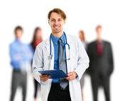 Handsome doctor in front of his patients — Stock Photo