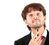 Thoughtful businessman holding a pen on his chin isolated on white — Stock Photo