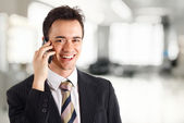 Young businessman talking at phone — Stock Photo