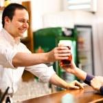 Bartender serving beer — Stock Photo #29930473