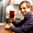 Stock Photo: Young mhaving beer in pub
