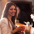 Woman drinking a cocktail — Stock Photo #29930569