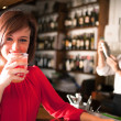 Woman drinking a cocktail — Stock Photo